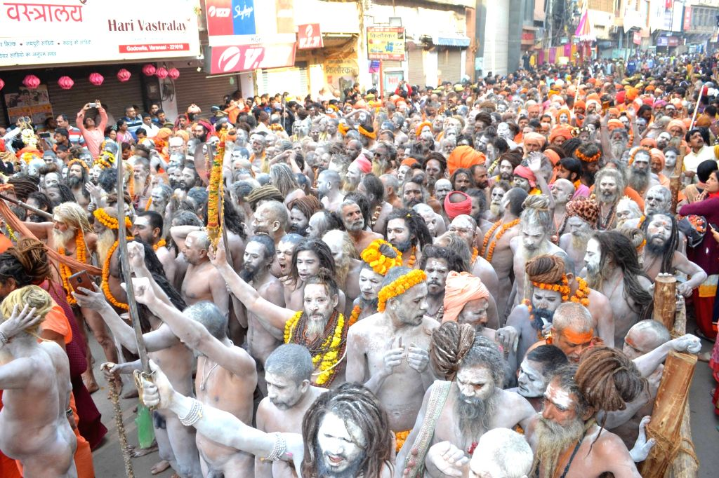 Naga sadhus' -ascetics- head towards Kashi Vishwanath Temple on Maha Shivratri in Varanasi on March 4, 2019.