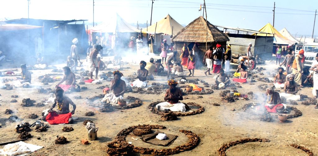 Naga Sadhus -ascetics- perform rituals during Magh Mela in Allahabad on Jan 22, 2018.