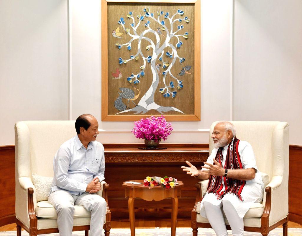 Nagaland Chief Minister Neiphiu Rio meets Prime Minister Narendra Modi, in New Delhi on June 15, 2019. - Neiphiu Rio and Narendra Modi