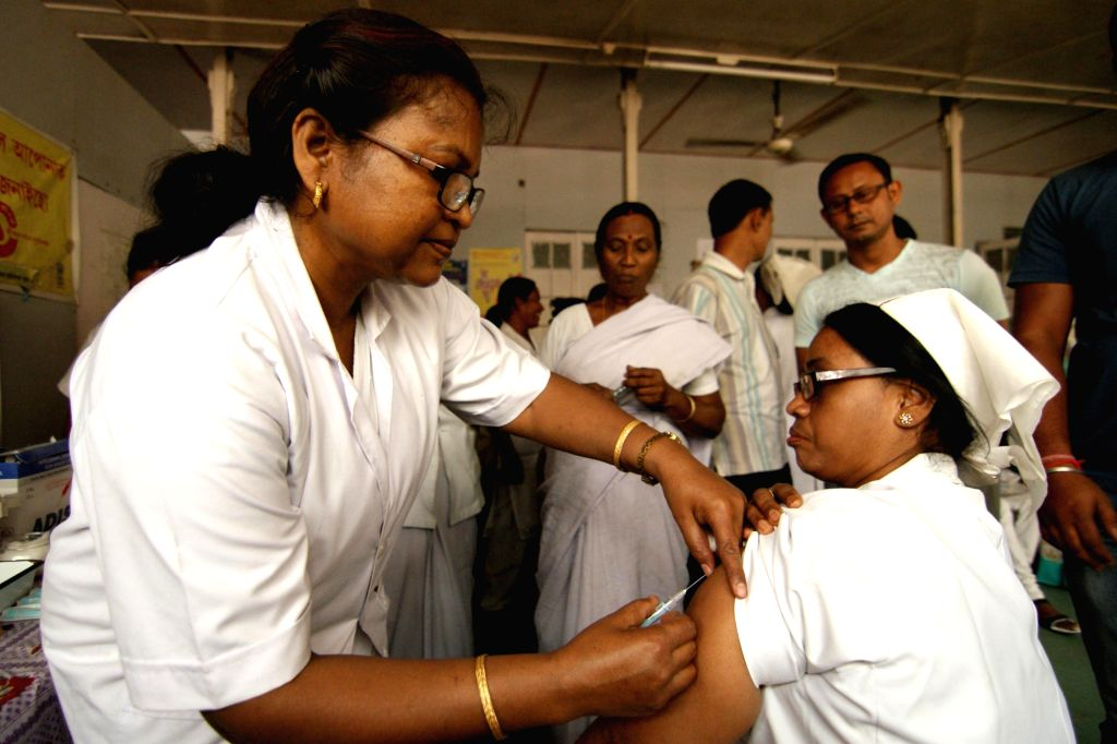 Nagaon: A nurse administers Japanese encephalitis (JE) vaccine to a man at a JE vaccination camp set-up at the Civil Hospital in Nagaon of Assam on March 26, 2015. (Photo: IANS)