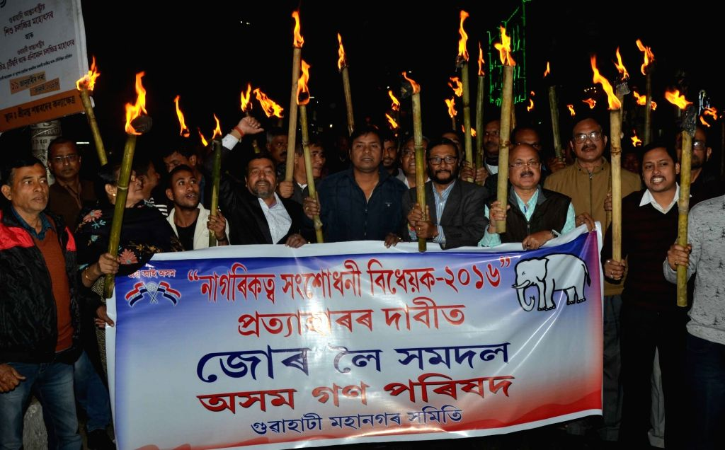 Nagaon: Asom Gana Parishad (AGP) activists participate in a torch light rally to protest against the Citizenship (Amendment) Bill in Assam's Nagaon on Jan 18, 2019. (Photo: IANS)