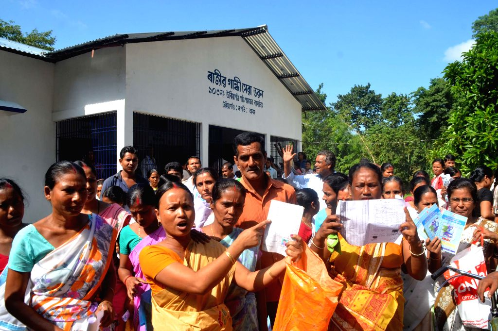 Nagaon: Labours protest against poor implementation of Mahatma Gandhi National Rural Employment Guarantee Act at Uriagaon in Nagaon district of Assam on Oct.28, 2014. (Photo: IANS)