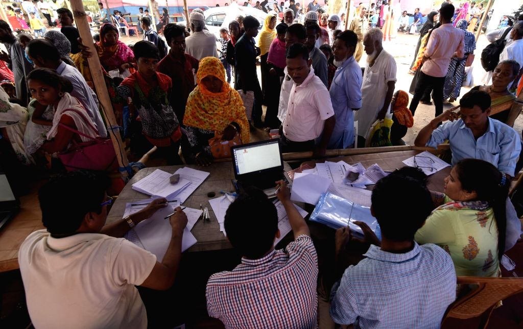 Nagaon: Residents whose names were left out in the draft National Register of Citizens (NRC) get their documents checked during an appeal hearing against the non-inclusion of names at an NRC office in Assam's Nagaon, on June 3, 2019. (Photo: IANS)