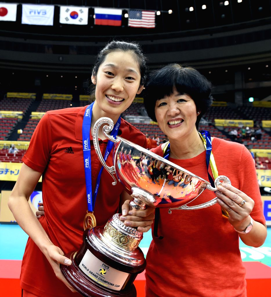 NAGOYA, Sept. 10, 2017 - Lang Ping (R), head coach of Chinese Women National Volleyball Team, holds the trophy with her player Zhu Ting after the awarding ceremony for FIVB Women's Grand Champions ...