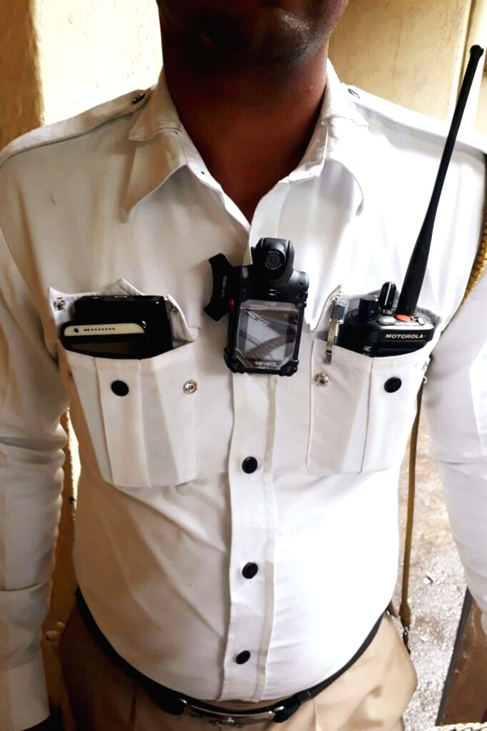 Nagpur: A Traffic Police personnel wears a body camera which is Wi-Fi enabled and will record live streamed clips to the main control room and the 'unedited' recordings will be used as evidence in case of altercations; in Nagpur on July 22, 2017. (Ph