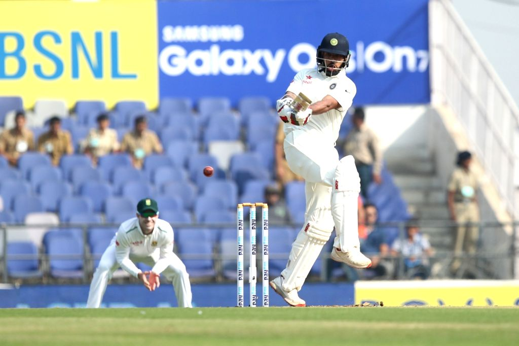 :Nagpur: Indian batsman Shikhar Dhawan in action during the Day-1 of the third test match between India and South Africa at Vidarbha Cricket Association Stadium in Nagpur  on Nov 25, 2015. (Photo: ...
