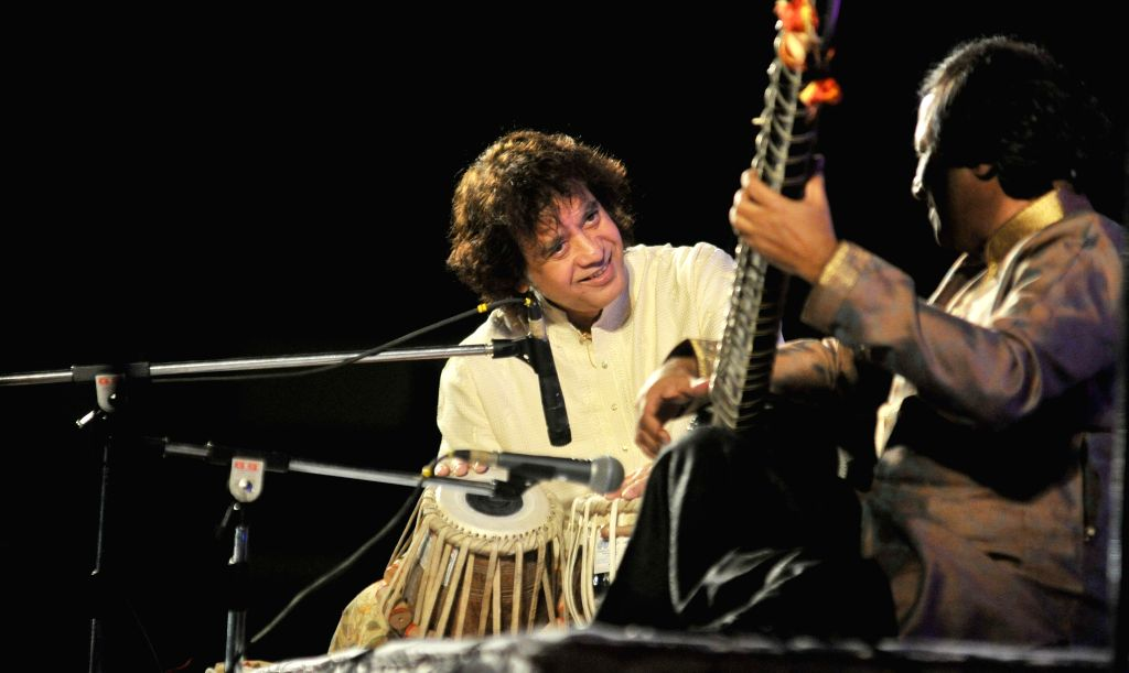 Indian tabla player Zakir Hussain and sitar player Ustad Shahid Parvez perform during the Swara Zankar Music Festival organised by the Violin Academy in Nagpur, on Feb 10, 2015.