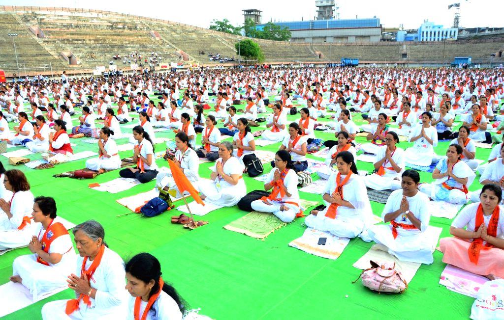Nagpur: People practice yoga asanas -postures- on International Yoga Day 2019 in Nagpur on June 21, 2019. (Photo: IANS)