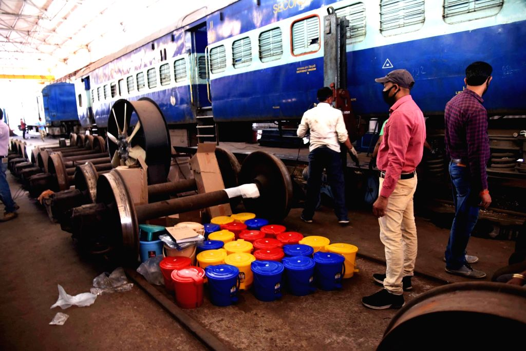 Nagpur: Railway technicians busy converting railway coaches into Isolation ward for COVID-19 patients amid coronavirus pandemic, in Patna on Apr 6, 2020. (Photo: IANS)