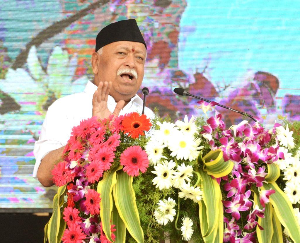 :Nagpur: Rashtriya Swayamsevak Sangh (RSS) chief Mohan Bhagwat addresses during the annual Vijayadashami celebration of the RSS at its Reshimbagh headquarters in Maharashtra's Nagpur on Oct ...