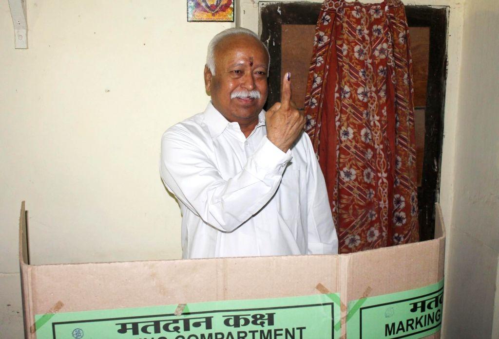 Nagpur: RSS Chief Mohan Bhagwat casts his vote during Nagpur Municipal Corporation polls in Nagpur on Feb 21,2017. (Photo: IANS)
