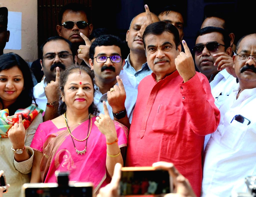 Nagpur: Union Minister Nitin Gadkari and his wife Kanchan Gadkari shows their inked finger after casting vote for Lok Sabha election at a polling station, in Nagpur, on April 11, 2019. (Photo: IANS) - Nitin Gadkari