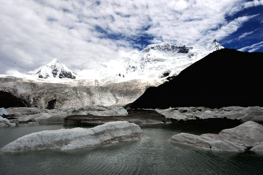Photo taken on July 10, 2014 shows the water that melts from glaciers on the Sapukonglagabo Mountain in Biru County of Nagqu Prefecture, southwest China's Tibet ...
