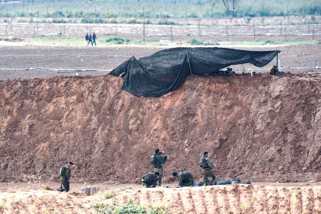 NAHAL OZ, March 30, 2018 - Israeli soldiers take position along the barrier between Gaza Strip and Israel in Nahal Oz, on March 30, 2018. At least seven Palestinians were killed and 500 wounded ...