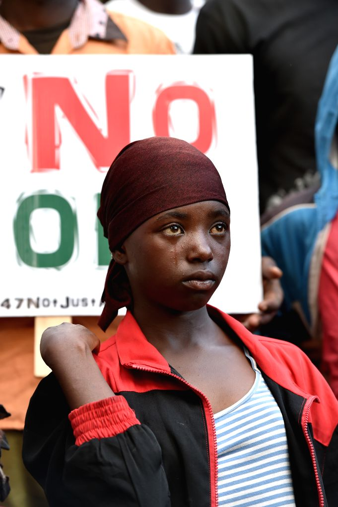 A girl sheds tears during a Garissa Memorial Concert to mourn the victims of the Garissa campus attack in Nairobi, Kenya, April 14, 2015.