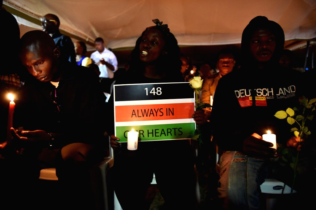 Local people attend a candlelight vigil for victims of the Garissa campus attack at Freedom-Corner in Uhuru Park, Nairobi, Kenya, April 7, 2015. Hundreds of Kenyans ...