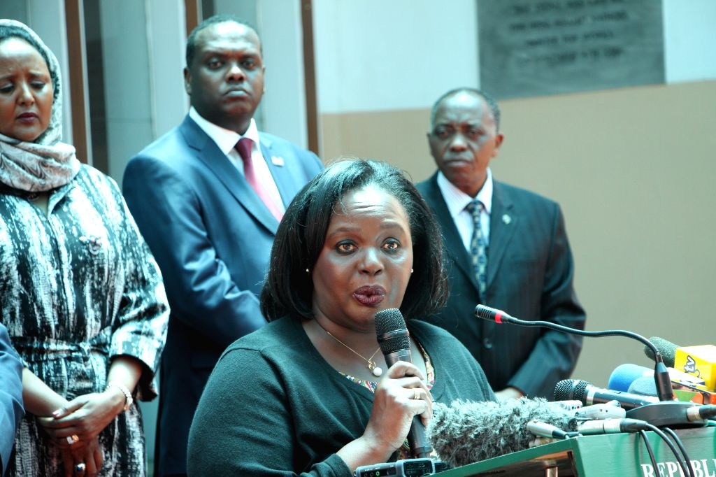 Kenya's Defense Cabinet Secretary Rachael Omamo (front) speaks during a press conference at the office of the president in Nairobi, capital of Kenya, April 8, 2015. ...