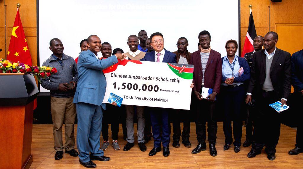 NAIROBI, Aug. 27, 2019 - Chinese Ambassador to Kenya Wu Peng (C) and scholarship recipients pose for photos during a ceremony in Nairobi, Kenya, on Aug. 27, 2019. The Chinese Embassy in Kenya on ...