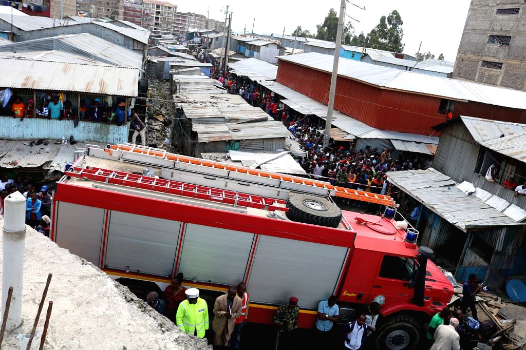 NAIROBI, Dec. 7, 2019 - A fire truck is seen at the scene of a collapsed building in Nairobi, capital of Kenya, Dec. 6, 2019. Death toll from the collapse of a building in Nairobi on Friday rose to ...