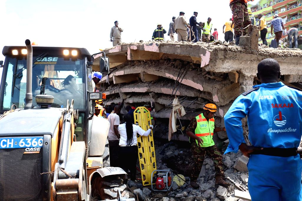 NAIROBI, Dec. 7, 2019 - Rescuers work at the scene of a collapsed building in Nairobi, capital of Kenya, Dec. 6, 2019. Death toll from the collapse of a building in Nairobi on Friday rose to five on ...