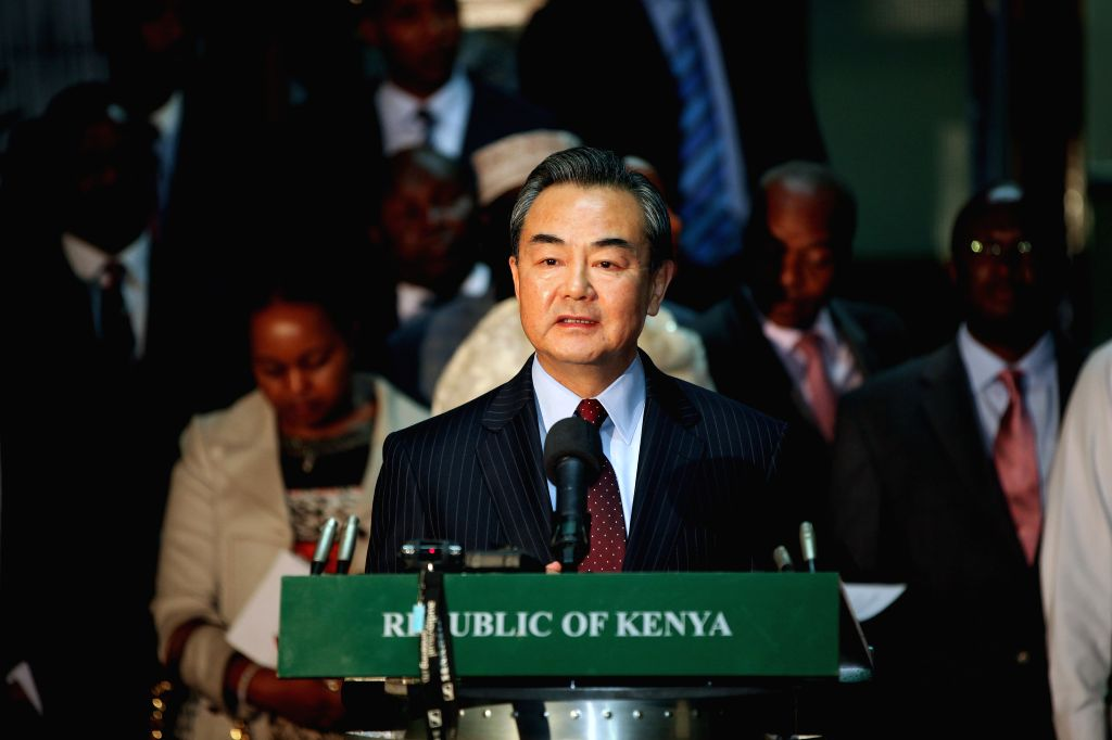 Chinese Foreign Minister Wang Yi speaks to reporters after talks with his Kenyan counterpart Amina Mohamed in Nairobi, capital of Kenya, Jan. 10, 2015. (Xinhua/Zhou - Wang Y