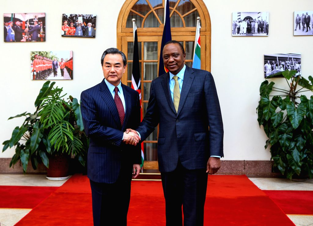 Kenyan President Uhuru Kenyatta (R) meets with Chinese Foreign Minister Wang Yi at the State House in Nairobi, capital of Kenya, Jan. 10, 2015. (Xinhua/Meng ... - Wang Y