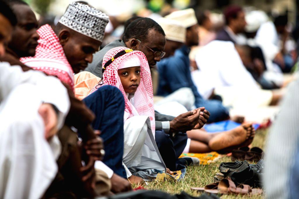 A Muslim boy attends Eid al-Fitr prayer at Sir Ali Muslim Club in Nairobi, Kenya, July 28, 2014. Kenyan Muslims on Monday celebrated the Eid al-Fitr festival, which