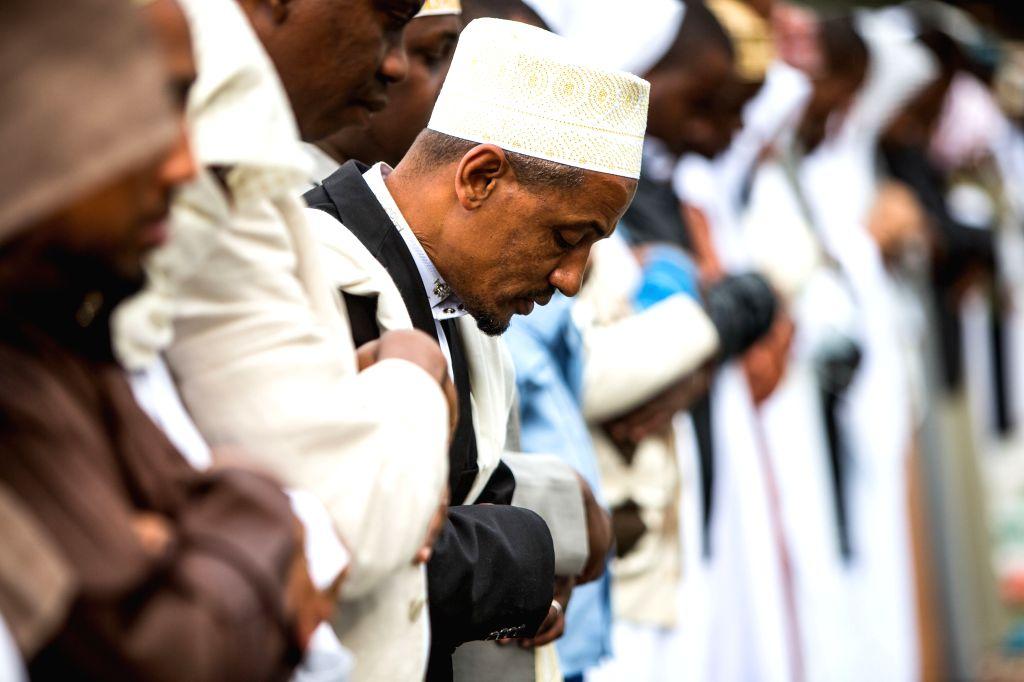 Muslims gather for Eid al-Fitr prayer at Sir Ali Muslim Club in Nairobi, Kenya, July 28, 2014. Kenyan Muslims on Monday celebrated the Eid al-Fitr festival, which ..
