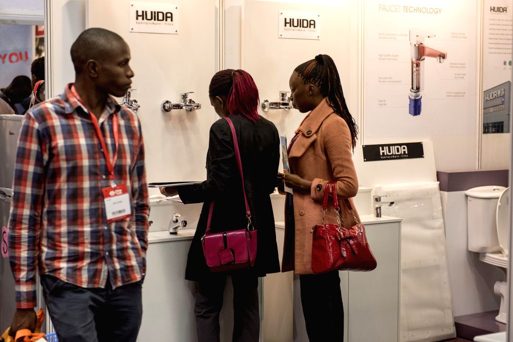 NAIROBI, June 29, 2016 - Visitors look at the sanitary products on display during the China Trade Week in Nairobi, Kenya, June 29, 2016. With the hope of developing African market, the second China ...