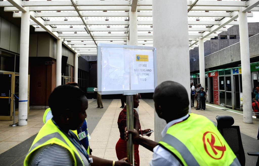 NAIROBI, March 10, 2019 - Staff members set up a signboard to offer help to relatives of the victims of the Ethiopian Airlines flight ET302 at the Jomo Kenyatta International Airport in Nairobi, ...