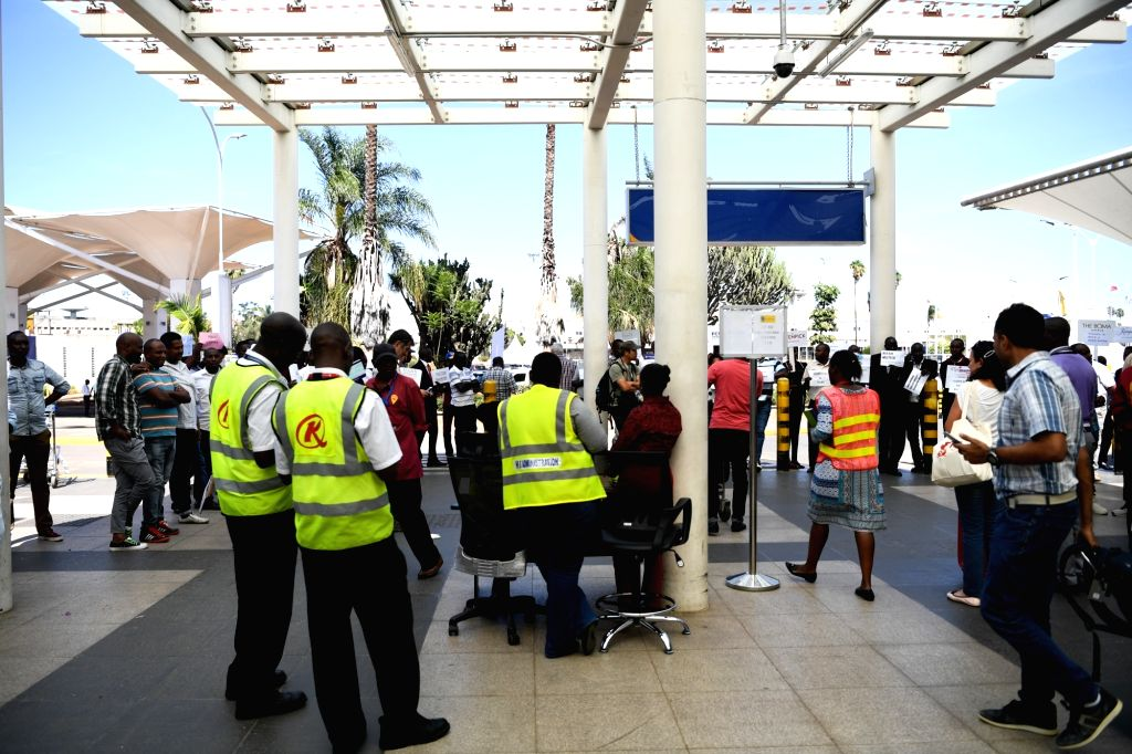 NAIROBI, March 10, 2019 - Staff members wait to offer help to relatives of the victims of the Ethiopian Airlines flight ET302 at the Jomo Kenyatta International Airport in Nairobi, capital of Kenya, ...