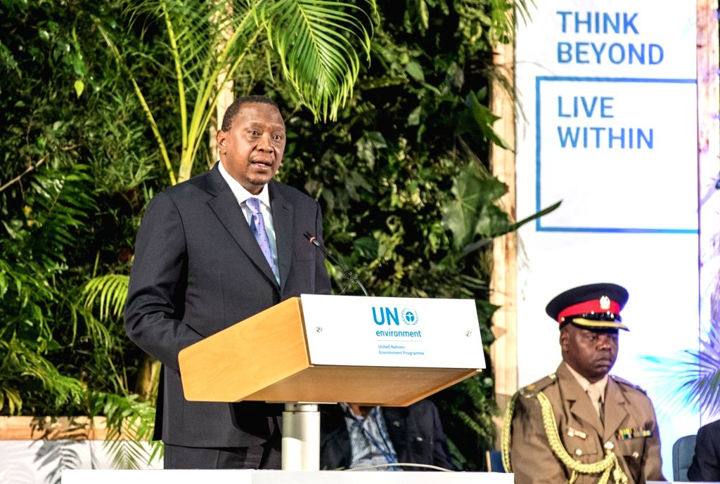 NAIROBI, March 14, 2019 (Xinhua) -- Kenyan President Uhuru Kenyatta (L) delivers a speech at the high-level segment of the fourth session of the UN Environment Assembly (UNEA) in Nairobi, Kenya, March 14, 2019. Heads of states and governments on Thur