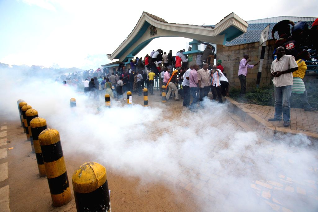 NAIROBI, May 17, 2016 - Opposition supporters run away from tear gas fired by policemen during a protest in Nairobi, Kenya, on May 16, 2016. Opposition leaders and their supporters protested against ...