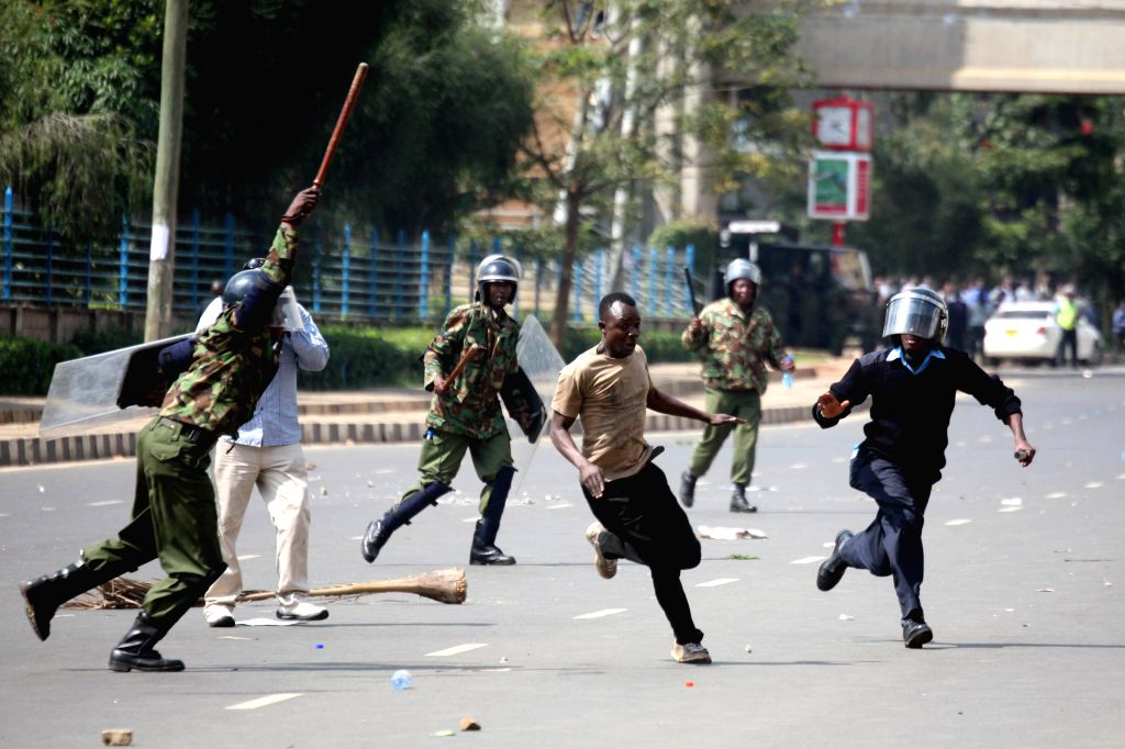 NAIROBI, May 17, 2016 - Policemen clash with opposition supporters during a protest in Nairobi, Kenya, on May 16, 2016. Opposition leaders and their supporters protested against the country's ...