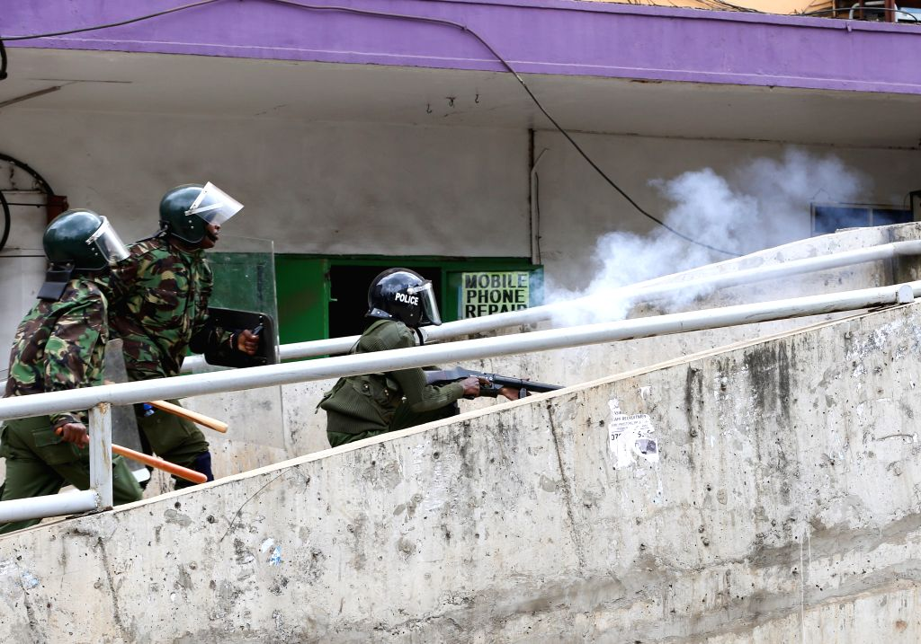 NAIROBI, May 23, 2016 - A Kenyan policeman fires teargas during a protest in Nairobi, Kenya, on May 23, 2016. One person was killed and scores injured in Kenya during countrywide protests to press ...