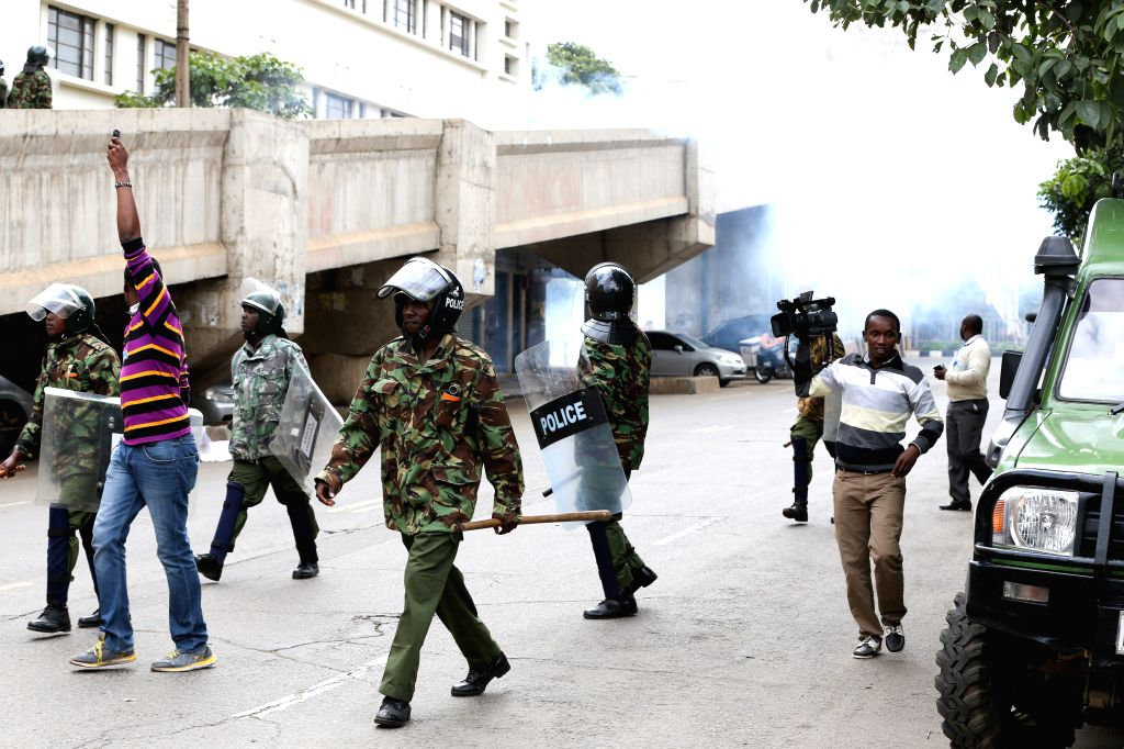 NAIROBI, May 23, 2016 - Kenyan policemen disperse crowds during a protest in Nairobi, Kenya, on May 23, 2016. One person was killed and scores injured in Kenya during countrywide protests to press ...