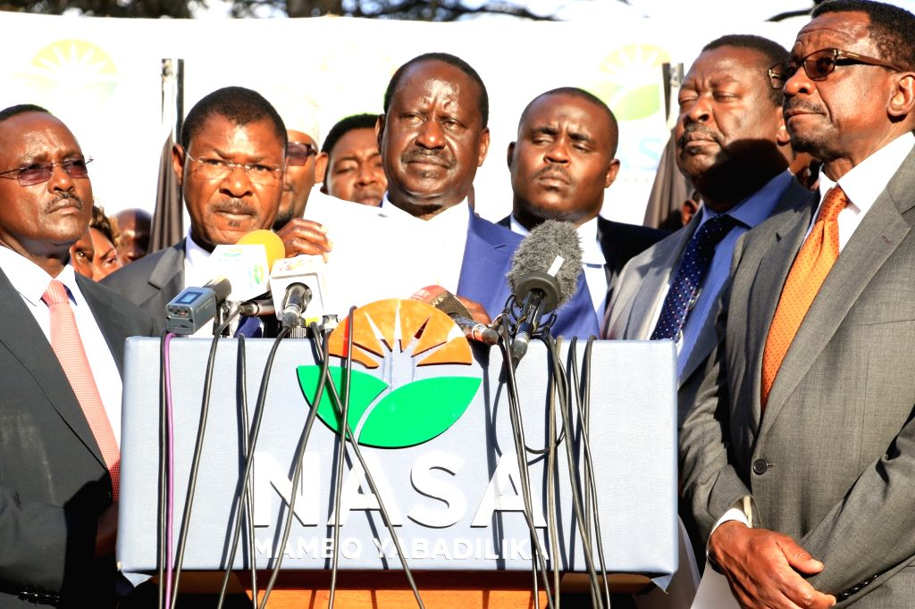 NAIROBI, Oct. 10, 2017 - Kenyan opposition leader Raila Odinga (3rd L) speaks during a press briefing in Nairobi, capital of Kenya, Oct. 10, 2017. Kenya's opposition leader Raila Odinga on Tuesday ...