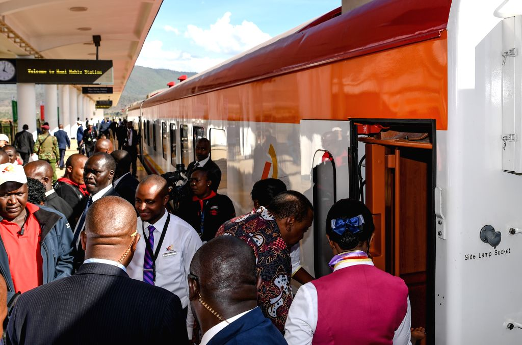 NAIROBI, Oct. 17, 2019 - Kenyan President Uhuru Kenyatta boards the train after the launching ceremony of Kenya's standard gauge railway (SGR) Phase 2A at Maai Mahiu Station in Kenya, Oct. 16, 2019. ...