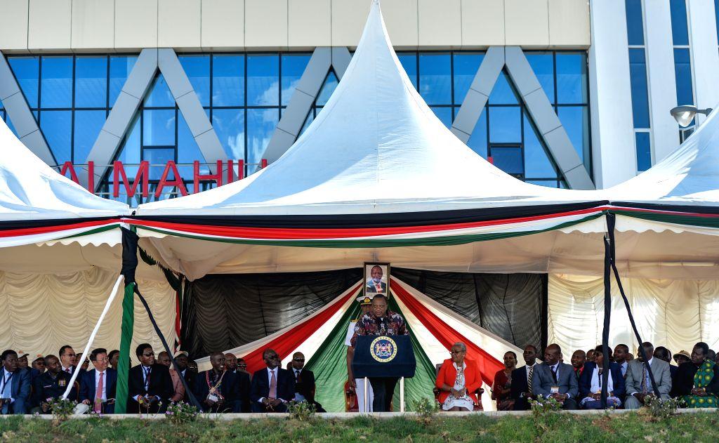 NAIROBI, Oct. 17, 2019 - Kenyan President Uhuru Kenyatta delivers a speech at the launching ceremony of Kenya's standard gauge railway (SGR) Phase 2A at Maai Mahiu Station in Kenya, Oct. 16, 2019. ...