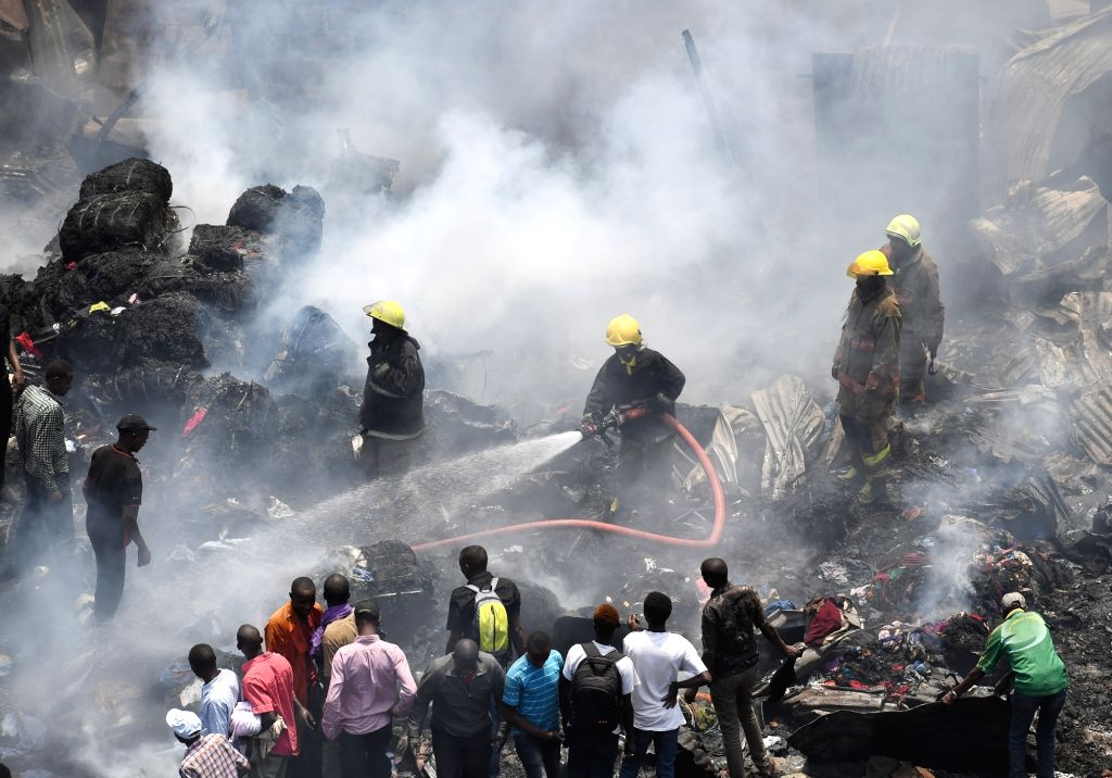 NAIROBI, Oct. 6, 2017 - Firefighters work at the Gikomba market in Nairobi, Kenya, Oct. 6, 2017. Kenya's largest open air market, Gikomba, located in downtown Nairobi was on Friday dawn razed to the ...