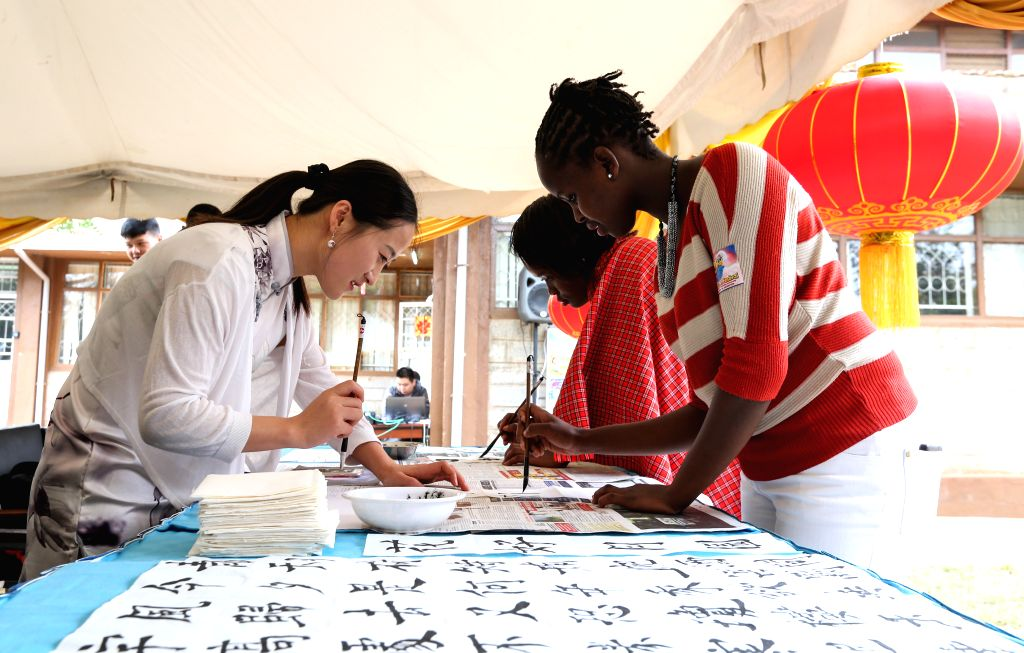 NAIROBI, Sept. 15, 2016 - Chinese teacher Deng Qianqian (L) teaches Chinsese calligraphy during the Mid-Autumn Festival celebration at Confucius Institute of the University of Kenyatta in Nairobi, ...