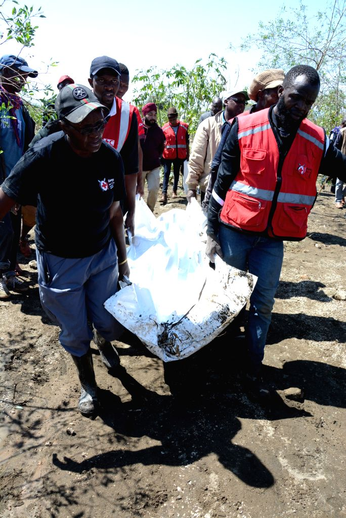 NAIVASHA (KENYA), Sept. 2, 2019 Kenya Red Cross workers carry the body of a victim that was swept away by floods at the Hell's Gate National Park in Naivasha, Kenya, on Sept. 2, 2019. ...