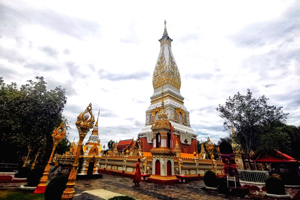 NAKHON PHANOM, May 19, 2019 - The?Laotian style Phra That Phanom Temple is seen in Nakhon Phanom, Thailand, May 9, 2019. Narongchai, a volunteer tour boat guide on the Mekong River in northeast ...