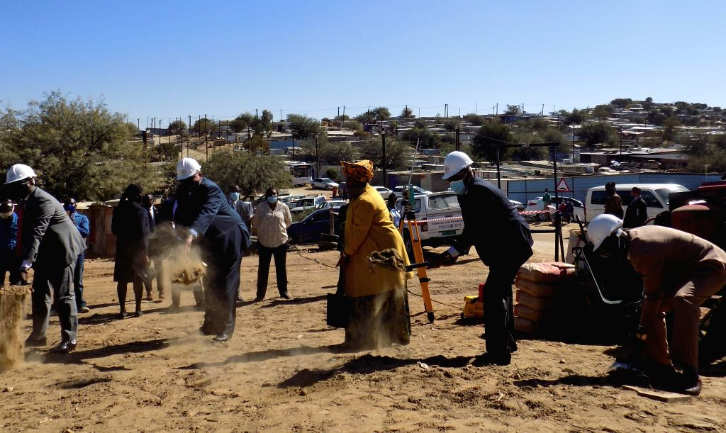 Namibia's Vice President Nangolo Mbumba (2nd R), together with other officials, attends the launch and groundbreaking ceremony of an affordable housing project in ...