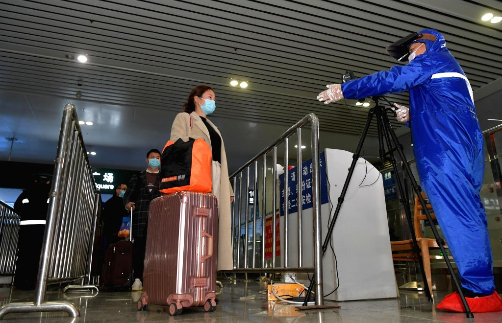 NANCHANG, Feb. 6, 2020 (Xinhua) -- A staff member checks the body temperature of passengers at the Nanchang Railway Station in Nanchang, east China's Jiangxi Province, Feb. 6, 2020. The station has intensified preventive measures to curb the novel co