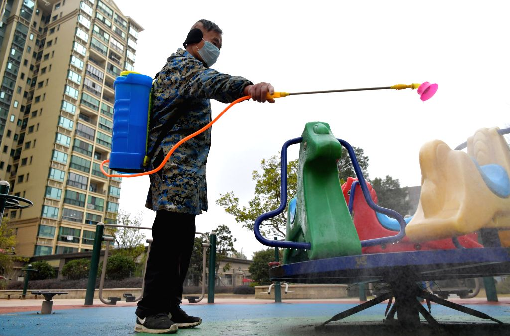 NANCHANG, Jan. 28, 2020 (Xinhua) -- A staff member disinfects pubilc facilities at a community in Nanchang County of Nanchang City, east China's Jiangxi Province, Jan. 28, 2020. The Nanchang county has established a multi-level prevention system to c