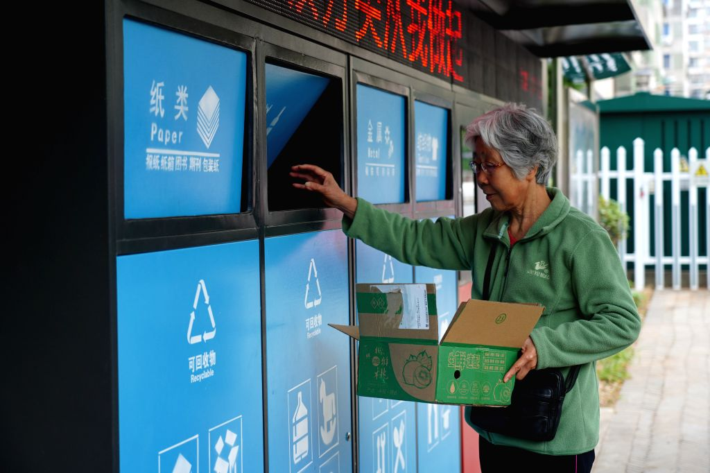 NANCHANG, Oct. 17, 2019 - A resident throws garbage into an intelligent garbage bin at Guangming community in Donghu District in Nachang City, east China's Jiangxi Province, Oct. 16, 2019. The ...