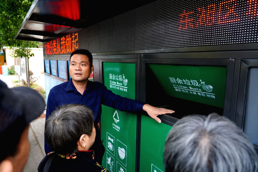 NANCHANG, Oct. 17, 2019 - A staff member introduces the usage of the intelligent garbage bin to residents at Guangming community in Donghu District in Nachang City, east China's Jiangxi Province, ...
