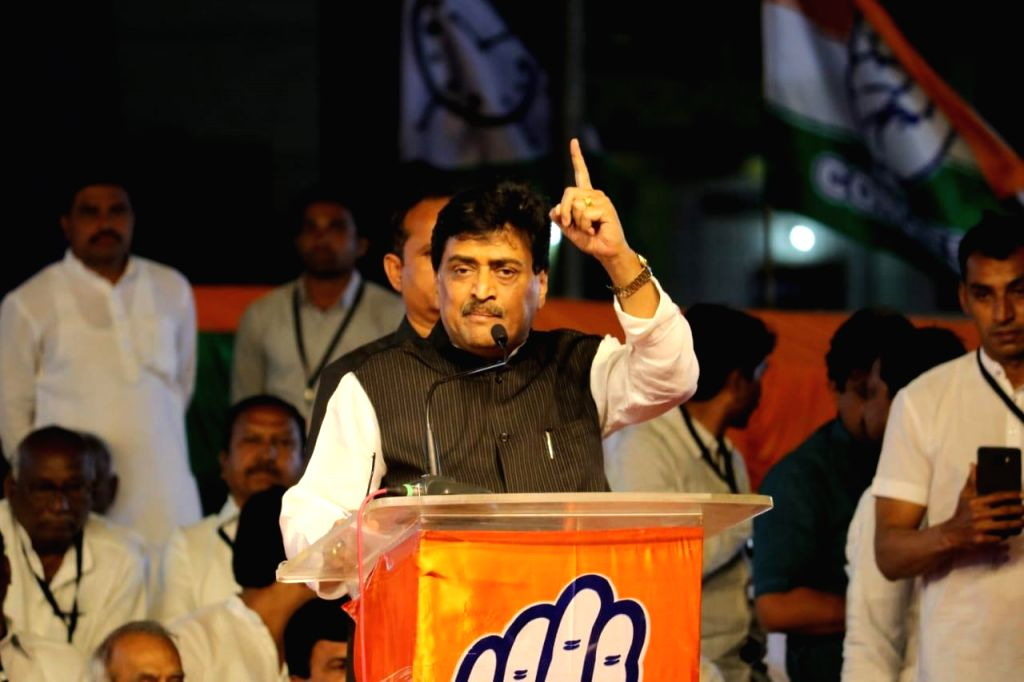Nanded: Maharashtra Congress president Ashok Chavan addresses during a rally ahead of the Lok Sabha polls in Maharashtra's Nanded on Feb 20, 2019. (Photo: IANS)
