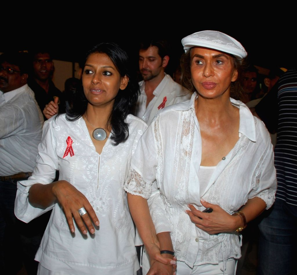 Nandita Das and Parmeshwar Godrej at the 26th International AIDS candlelight memorial to pay tribute to to AIDS Heroes. - Nandita Das